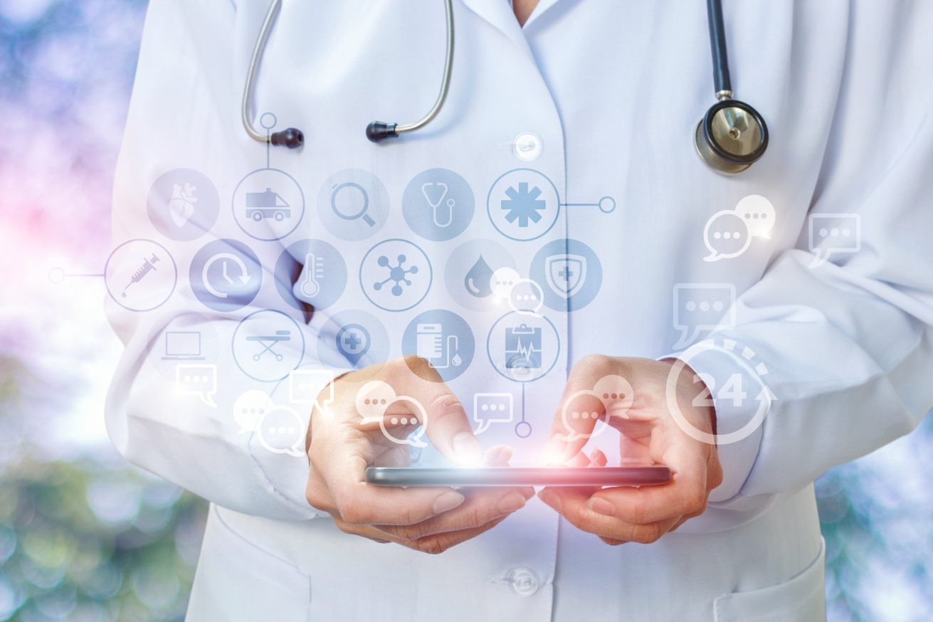 Doctor's tablet is gaining prescription in the correspondence on blurred background.